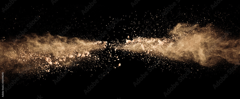 Fototapety, obrazy: Abstract colored brown powder explosion isolated on black background.