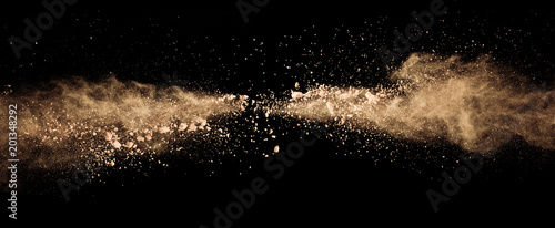 Obraz Abstract colored brown powder explosion isolated on black background. - fototapety do salonu