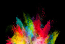 Abstract Colored Powder Explosion Isolated On Black Background.