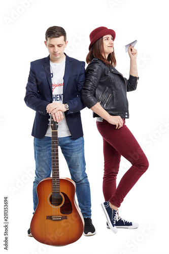 A musical duet is a guy with an acoustic guitar, and a girl with a paper airplane Poster