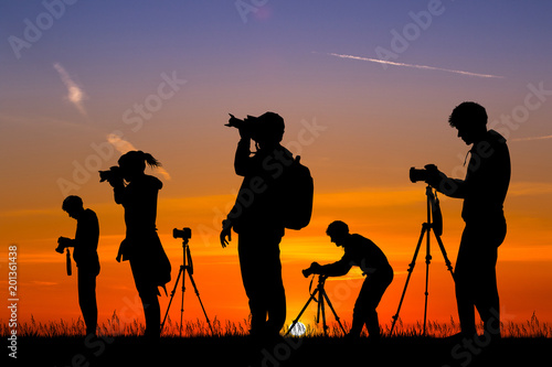 illustration of photographers at sunset