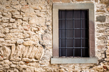 Window In Stone Wall. Barred Window.
