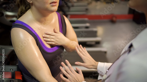 Photo Therapist helping woman to calm down and recover breath after active workout