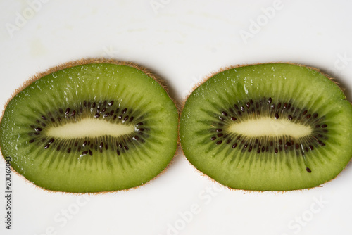 Two slices of kiwi fruit