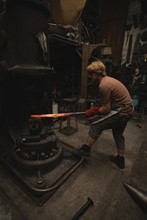 Blacksmith Shaping Hot Metal R...