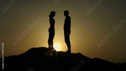Couple on top of hill against sunset, fateful meeting on edge of earth, love Canvas Print