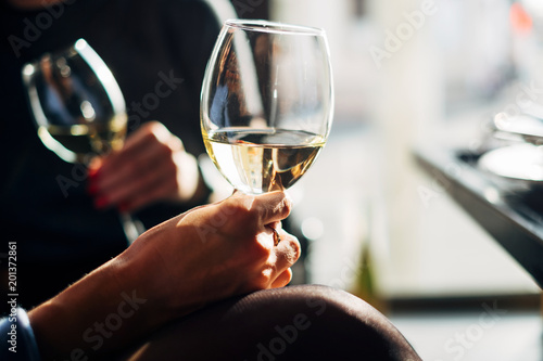 Two women sitting at a table enjoying a glass of wine