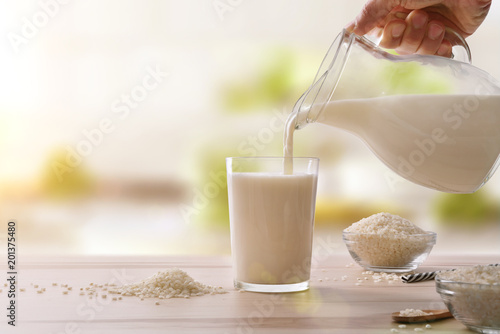 Serving rice drink in a glass in a kitchen
