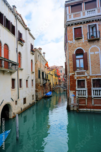 Fototapety, obrazy: Venice, Veneto / Italy - March 2018: Colorful buildings line the waterway in Venice, Italy.