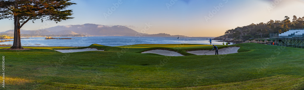 Fototapety, obrazy: Pebble Beach Golf - Pebble Beach, California, February 17, 2018:  The famous 18th hole at the Pebble Beach golf links offers assorted seaview vistas in addition to challenging golf shots.