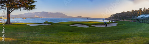 Pebble Beach Golf - Pebble Beach, California, February 17, 2018: The famous 18th hole at the Pebble Beach golf links offers assorted seaview vistas in addition to challenging golf shots.