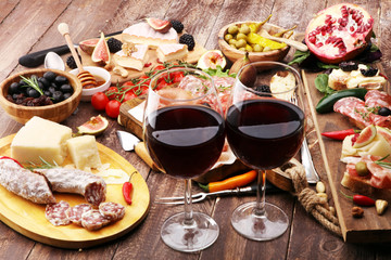 Italian antipasti wine snacks set. Cheese variety, Mediterranean olives, pickles, Prosciutto di Parma and salami
