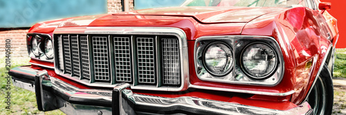 red shiny muscle car front ...