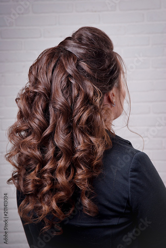 Hairstyle Long Curls On The Head Of A Brunette Look Right Against