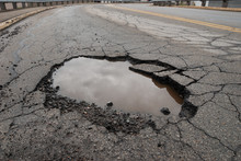 Pothole In Road With Broken As...