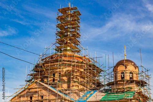 KOMLEVO, RUSSIA - JULY 2017: Construction of the Church of the Nativity of John the Baptist (Rozhdestva Ioanna Predtechi) in the village of Komlevo