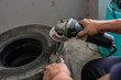 A man working with grinder