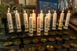 First holy communion or confirmation burning candles rowed up in church before ceremony beautiful decoration