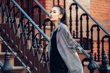 Beautiful Asian Girl Walking On Urban City Neighborhood Street Wearing Fashionable Clothes