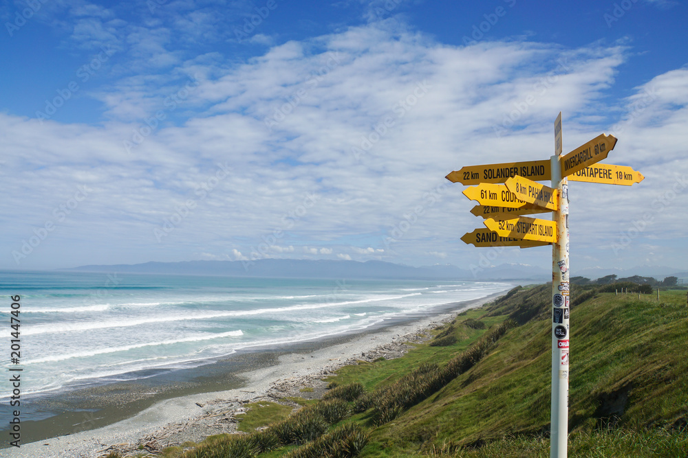 Fototapety, obrazy: direction and  distance post in McCrackens Rest in New Zealand taken on 4 November 2017