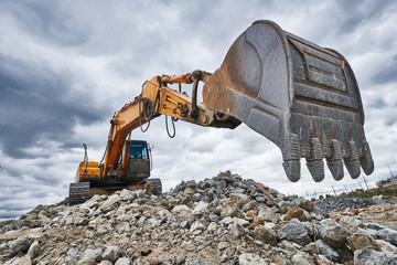 excavator loader machine at demolition construction site