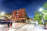 Fototapeta Sawanna - SAVANNAH, GA - APRIL 2, 2018: Tourists enjoy city streets at night. Savannah hosts 15 million tourists annually