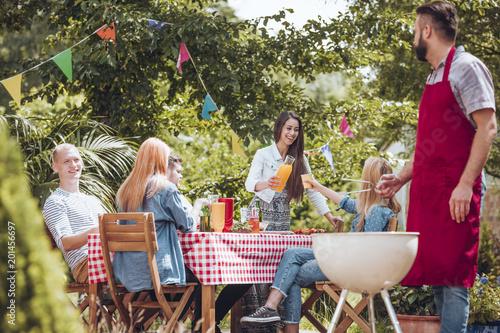 Fotografie, Obraz  Friends partying in garden