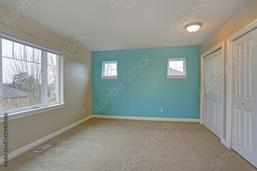 Light empty room interior with focus on a bright blue wall Wallpaper Mural