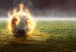 canvas print picture Brennender Fußball auf Rasenfläche