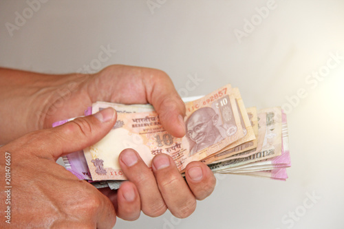 A man's hand holds Indian money and counts them Tapéta, Fotótapéta