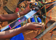 Weavers producing the traditional African fabric kente