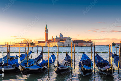Poster Venetie Venetian gondolas at sunrise on Grand Canal by San Marco square, Venice, Italy.