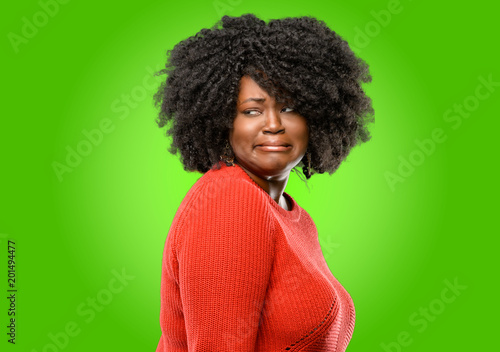 Fotografie, Tablou  Beautiful african woman feeling disgusted with tongue out