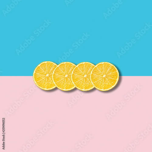 Minimal abstract illustration with group of lemon slices on pastel background