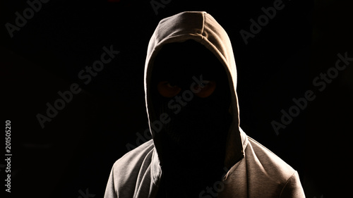 Mysterious man with hoodie on the black background Canvas Print