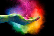 Magical rainbow colored dust exploding from a hand. Holi Festival