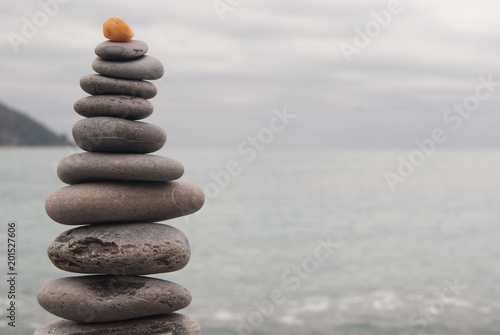 Acrylic Prints Stones in Sand Pyramid of characteristic pebbles of Camogli