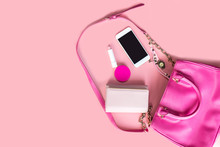 Top View Of Women Bag And Lady Stuff With Copyspace On Pink Background, Vigtage Effect Photo