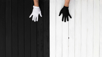 Hands in black and white gloves on a black and white background