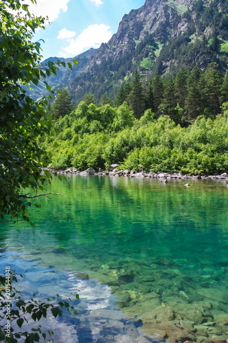 Photo Stands Water surface of a high-mountainous glacial lake, vertical.