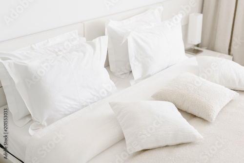 Valokuva  Comfortable soft pillows on the bed