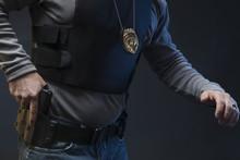 Law Enforcement Agent Studio Shoot With Hand On Gun.