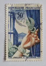 Leeds, England - April 20 2018: An Old Blue French Postage Stamp With An Image Of A Female Hand Holding Stylish Jewelry
