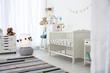 Cozy baby room interior with crib