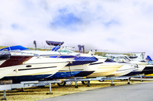 Boat On Stand On The Shore, Close Up On The Part Of The Yacht, Luxury Ship, Maintenance And Parking Place Boat