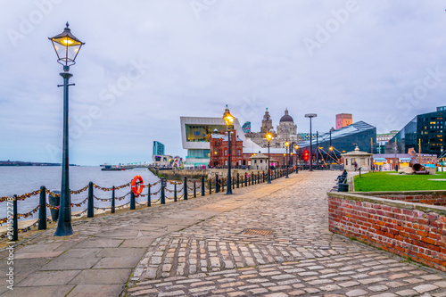 Poster Jogging Waterside of Liverpool dominated by the museum of Liverpool an the pilotage house, England