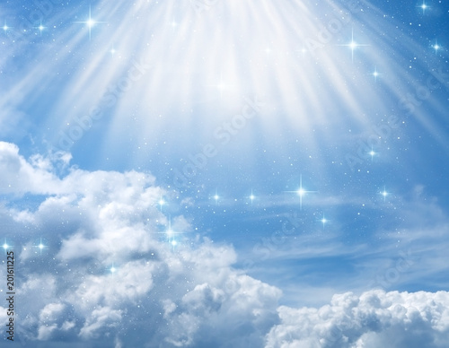 divine, mystical, angelic blue background with cloudy sky, rays of light and stars  Wall mural