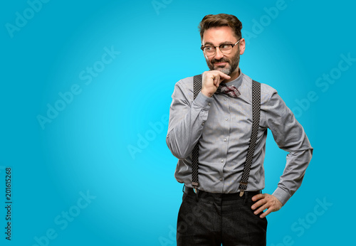 a32ad8461bcb Middle age man, with beard and bow tie thinking thoughtful with smart face,  expressing
