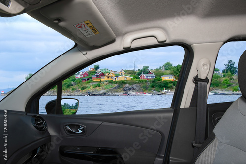 Car window overlooking houses on the shore, Oslo fjord, Norway Poster