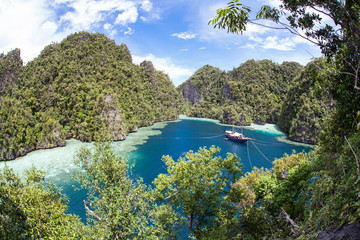 Tropical Paradise and Moored Ship in Raja Ampat